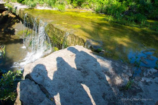 Standing at the top of the Chase County Lake waterfalls