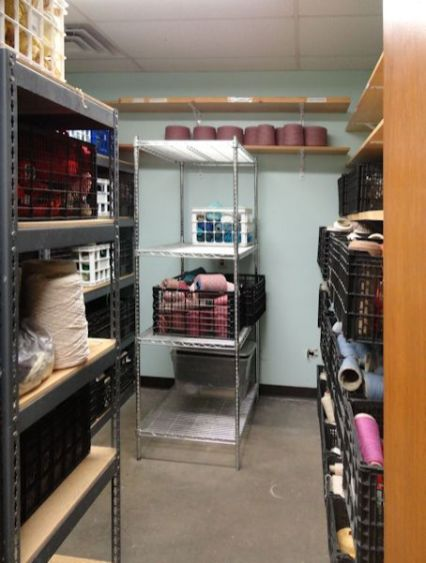 Balls of yarn and additional cones will fill up this storage space,