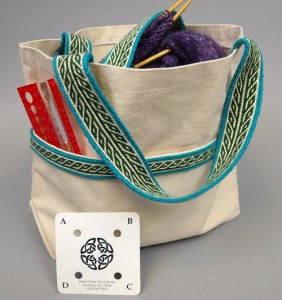 Canvas bag with tablet woven handles