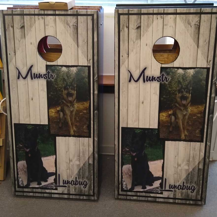 Add your pets in picture frames on your custom cornhole board sets.