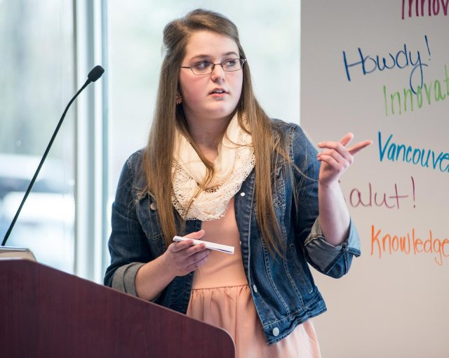 Rylee Foster of Campobello Consolidated School explains her idea to help fishermen who go overboard in the Bay of Fundy. (Michael Hawkins/Wicked Ideas)