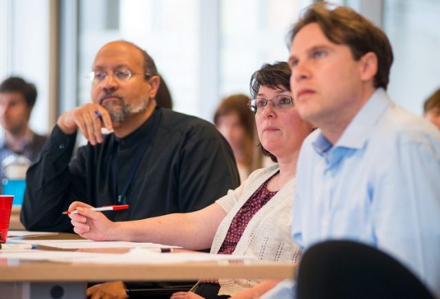 Dr. Bill McIver, Susan Almon and Giles Counsell listen to the pitches. (Michael Hawkins/Wicked Ideas)