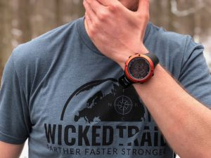 Blue Wicked Trail shirt and Suunto watch