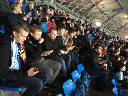 The lads sit down to enjoy the game