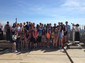 The group enjoy the sunshine with the Eiffel Tower in the background