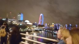 A blurry snap of The London Eye illuminated to honour those who tragically lost their lives in Paris