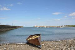 A rowing skiff on the beach in Wicklow Harbour, home of Wicklow Rowing Club