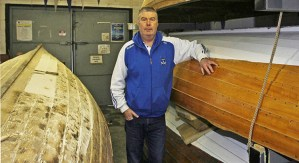 Rob Dunne Chairman of Wicklow Rowing Club inside the clubhouse with boats