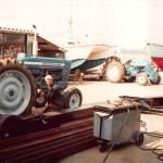 Tractor maintenance underway