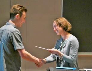 Janine Utell, Chair of English and Creative Writing, presents the Hastie Memorial Award to Evan Kramer