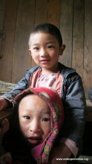 Two kids in a (wooden) tea house