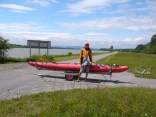 Kelsey pauses for a photo op with the kayak on a carrier similar to what is found at every large dam in Germany and Austria.