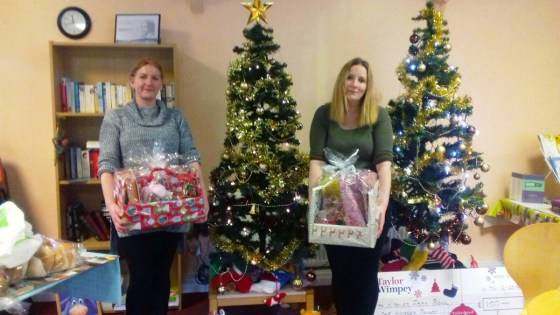 Foodbank volunteers with Christmas donations