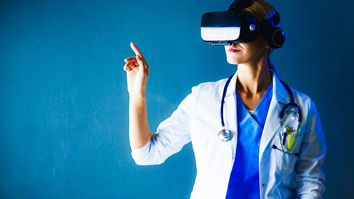 Female doctor wearing virtual reality glasses isolated on white background. © lenets_tan – stock.adobe.com