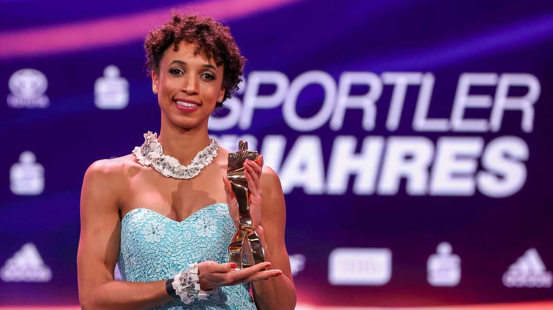 """Malaika Mihambo poses with her """"Sportswoman of the Year"""" award during the """"Sportler des Jahres"""" Gala (German athlete of the year) at Kurhaus Baden-Baden on December 20, 2020 in Baden-Baden, Germany. (Photo by Alexander Hassenstein/Getty Images)"""