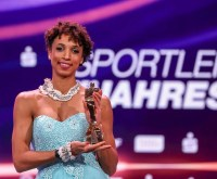 "Malaika Mihambo poses with her ""Sportswoman of the Year"" award during the ""Sportler des Jahres"" Gala (German athlete of the year) at Kurhaus Baden-Baden on December 20, 2020 in Baden-Baden, Germany. (Photo by Alexander Hassenstein/Getty Images)"