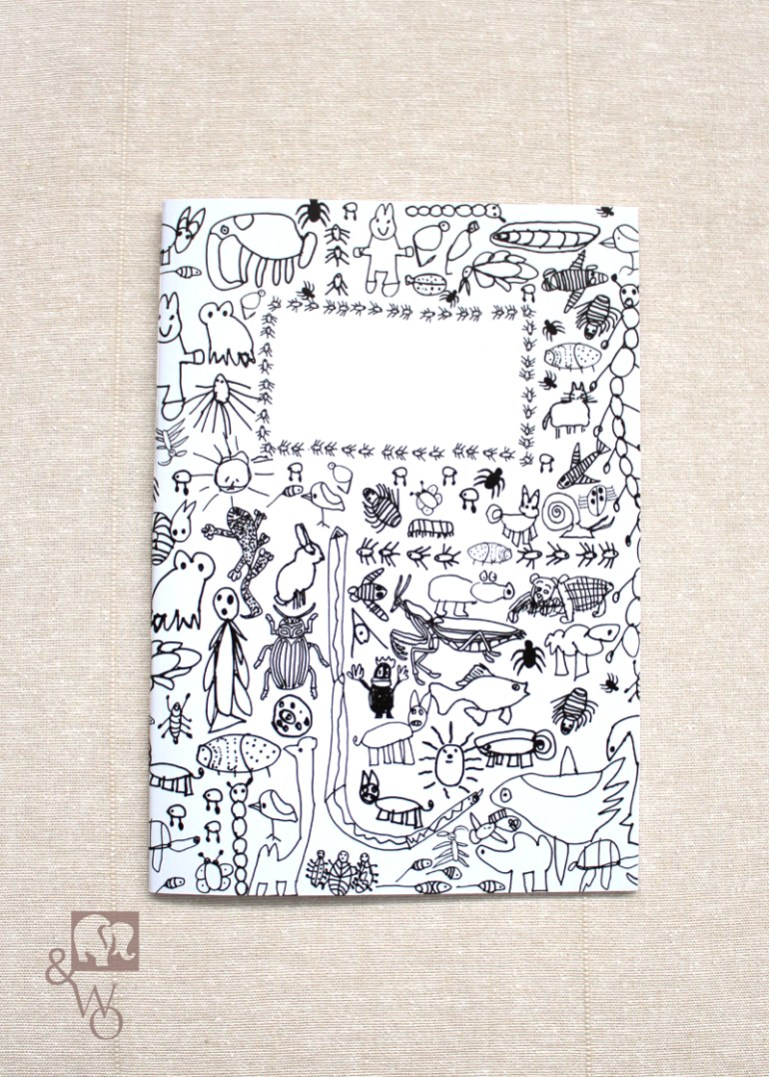 lined A6 notebook with black and white critter illustrations