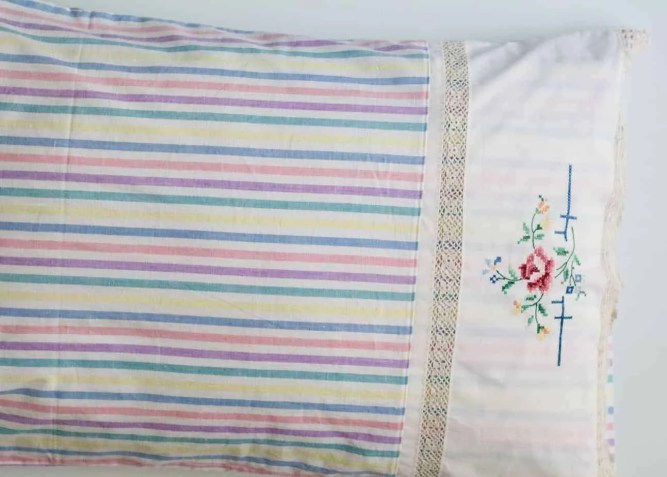 Wife-made vintage pillowslip with crochet edging