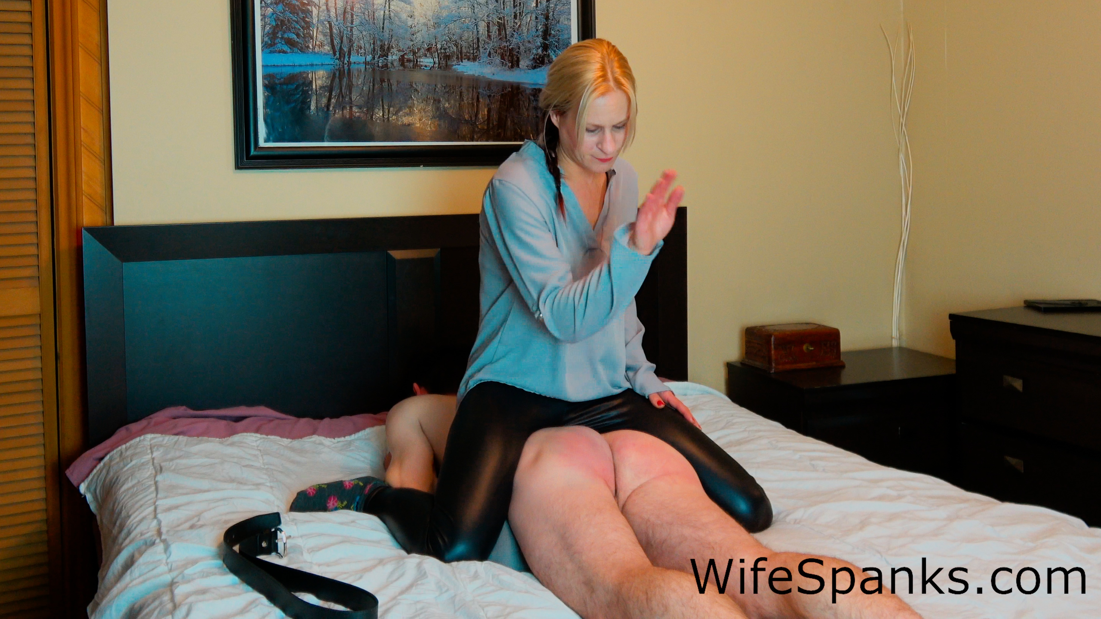 Wife spanks hubby in front of