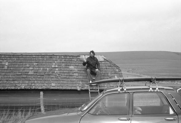 Keith Williams repairing the hut roof