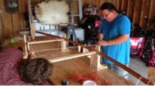 A series of height-blocks and temporary thwarts lets Wayne place the gunwale pieces in their proper place and bend them into shape. Lengths of string are used to tie the pieces in place as they dry (Photo Credit: Marcus Cederström)
