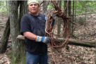 Wayne Valliere, Mino-Giizhig in Ojibwe, holding recently harvested spruce roots (Photo Credit: Tim Frandy)