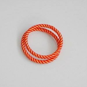Prepletaná gumičkadovlasov s lurexom pre ženy a detí. Farba- oranžová. Rozmer: 0.5cm x 6cm