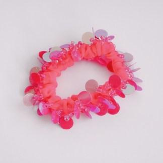 Gumičkadovlasov s flitrovanými ozdobami. Farba- ružová. Rozmer: 6cm x 2cm