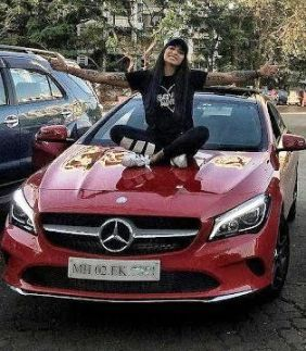 Bani J With Her Car