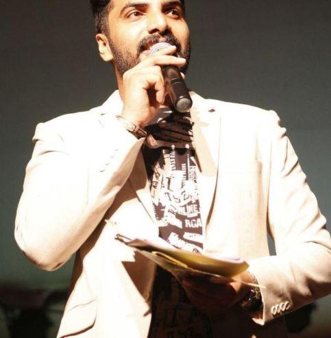Anoop Krishnan anchoring for a show
