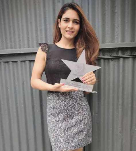 Mukti Gautam winning the award for the Best Fitness Blogger 2019