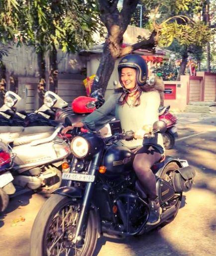 Nidhi Subbaiah riding a bike