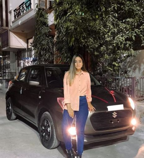 Anicka with her car