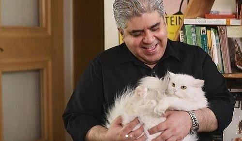 Rajeev Masand with pet cat of Richa Chadha