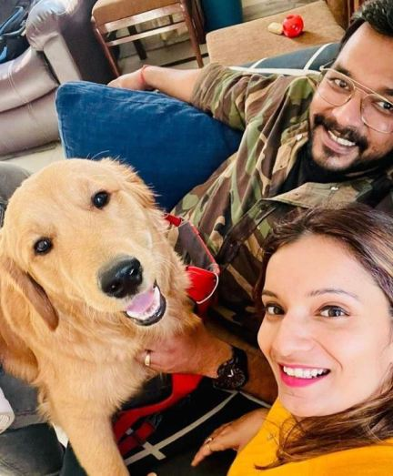 Apoorv Singh Karki with his wife and pet dog