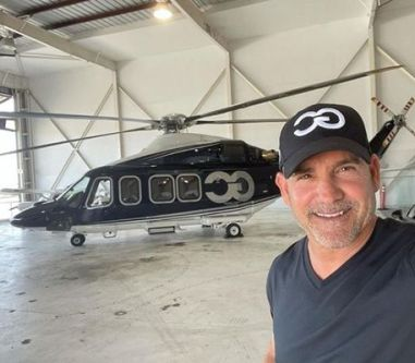 Grant Cardone with his AgustaWestland AW139