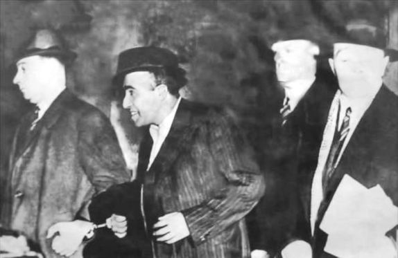 Udham Singh (second from the left) being taken after the assassination of Michael O€™Dwyer
