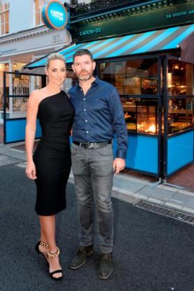An Image of Padraig McLoughlin and his wife Kathryn Thomas outside there restaurant