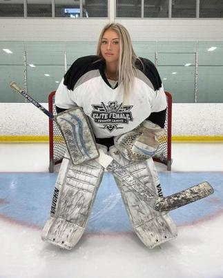 A Photo of Mikayla Demaiter in her ice hockey kit