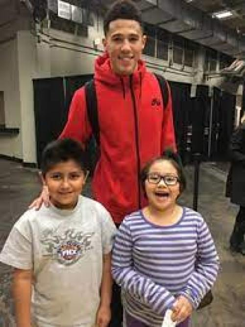 An Image of Mya Powell and her brother Devin Booker