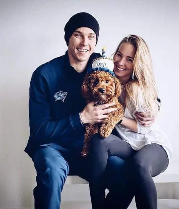 An Image of Aleksandra Merzlikins and her husband Elvis Merzlikins