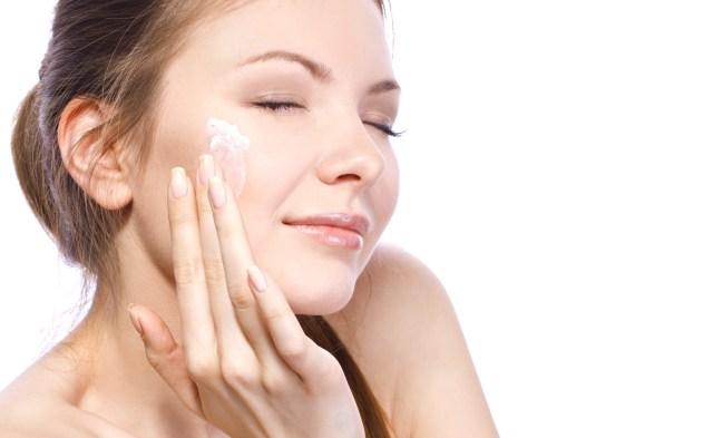 applying cream for face
