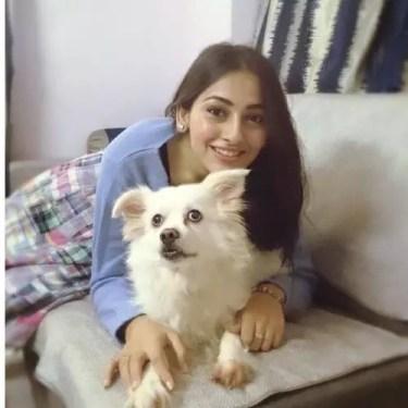 Anagha Bhosale with pet dog