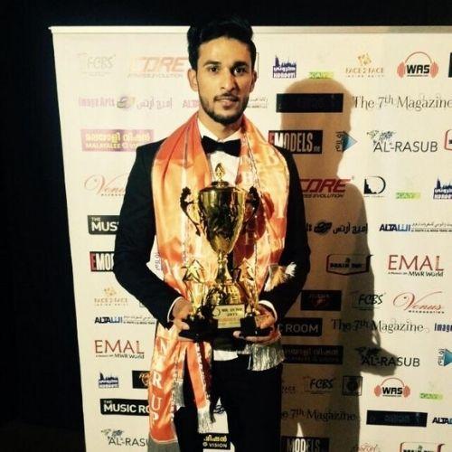Dileep R Shetty with trophy of Mr. Dubai