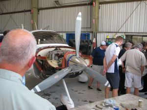 Cirrus SR20 in a maintenance hangar with cowling off, photo by wikiWings