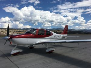 2008 Cirrus Perspective SR22TN Turbo, Eagle County Airport (KEGE) Colorado, blue sky and scattered clouds, photo credit wikiWings
