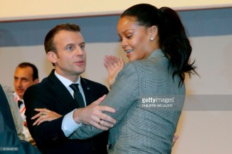French President Emmanuel Macron embraces Barbadian singer Rihanna as they attend the conference 'GPE Financing Conference, an Investment in the Future' organised by the Global Partnership for Education in Dakar on February 2, 2018, as part of Macron's visit to Senegal. The French and Senegalese presidents are co-hosting a conference organised by the Global Partnership for Education, aimed at pressuring donors to finance the education of a quarter of a billion children worldwide who are currently out of school, while Rihanna is attending as a global ambassador for the organisation. / AFP PHOTO / POOL / PHILIPPE WOJAZER (Photo credit should read PHILIPPE WOJAZER/AFP/Getty Images)