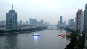 stock-footage-steam-ships-dock-to-quay-along-embankment-with-moving-machines-on-sunset-time-lapse