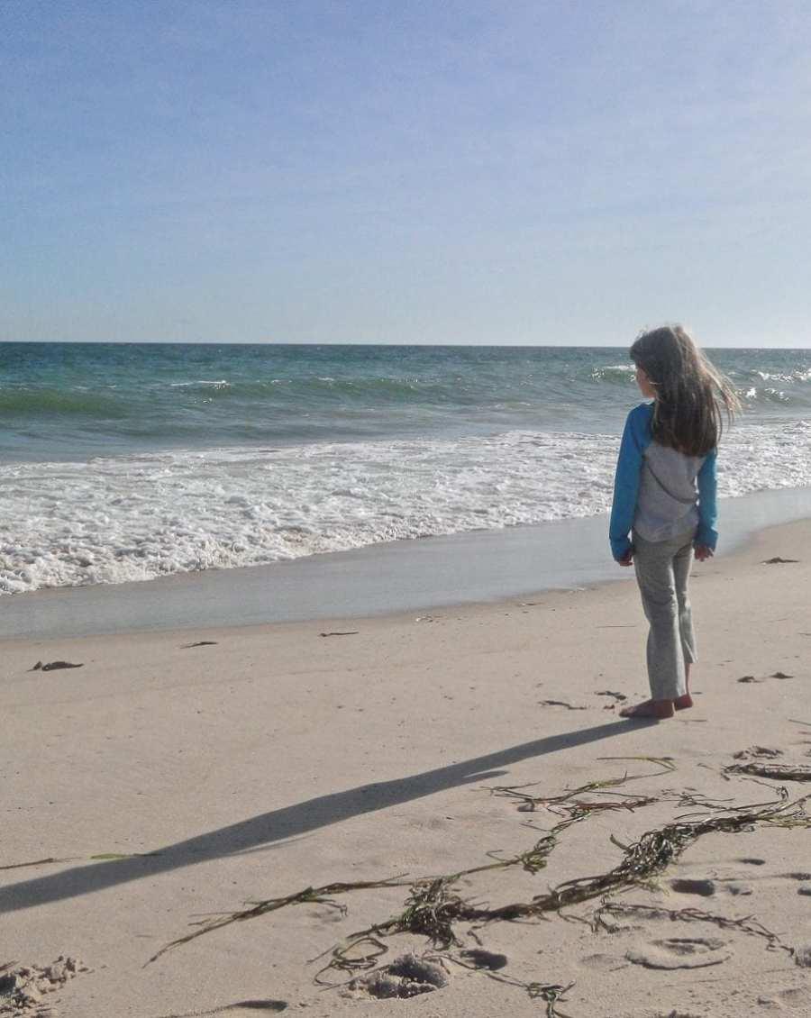 beach walk with kids watching waves