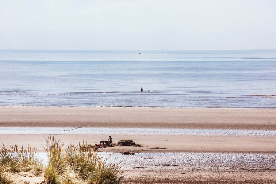 Camber Sands beach with sand castle and kids